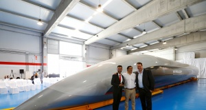 Hyperloop TT co-founder and CEO, Dirk Ahlborn, Airtificial co-founder and chairman, Rafael Contreras and Hyperloop TT chairman and co-founder, Bibop Gresta pose next to the world's first full-scale passenger Hyperloop capsule during its present