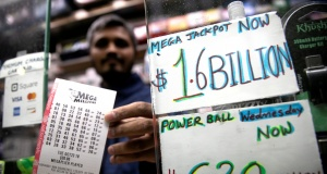 A newsstand vendor displays tickets for Tuesday's Mega Millions lottery drawing in New York City
