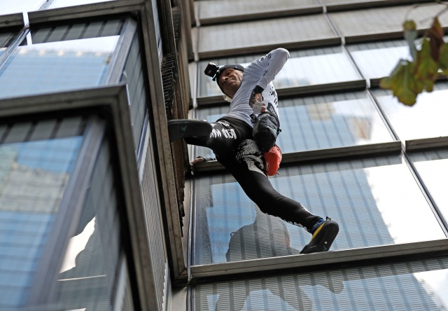 French free-climber Alain Robert, known as 'Spiderman', attempts to climb up the outside of the Heron Tower in the financial district of London