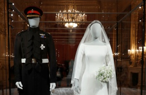 The wedding outfits of Meghan, Duchess of Sussex, and Harry, Duke of Sussex, are on display ahead of the exhibition A Royal Wedding, soon to open at Windsor Castle, in Windsor