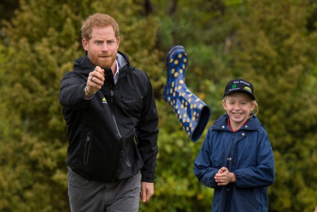 Britain's Prince Harry participates in a contest during an event unveiling the Queen's Commonwealth Canopy in Redvale, North Shore, New Zealand