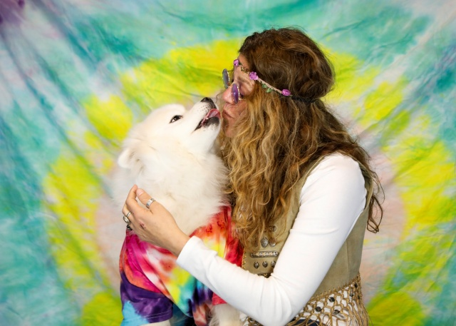 A staff members poses with a dog during a 'Wuffstock' Halloween event, at the Morristown Animal Inn in Morristown, New Jersey