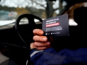 A driver shows a card encouraging speeding driver to become an organ donor in Parnu