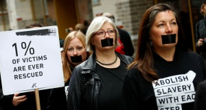 Activists take part in a 'Walk for Freedom' to protest against human trafficking in Berlin