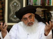 Khadim Hussain Rizvi, leader of Tehrik-e-Labaik Pakistan Islamist political party gestures during an interview with Reuters in Lahore