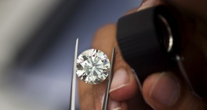 A trader inspects a diamond at Israel's Diamond Exchange near Tel Aviv