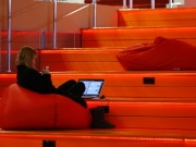 A woman with a laptop is seen in Hi-Tech Park Belarus building in Minsk