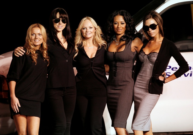 The Spice Girls pose after the unveiling of a Virgin Atlantic Boeing 747 plane named Spice One in honor of the pop group at Los Angeles international airport