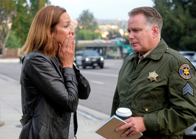 Member of the California State Assembly Jacqui Irwin and Ventura County Sheriff Sgt. Eric Buschow comfort each other during a news conference after a mass shooting at a bar in Thousand Oaks