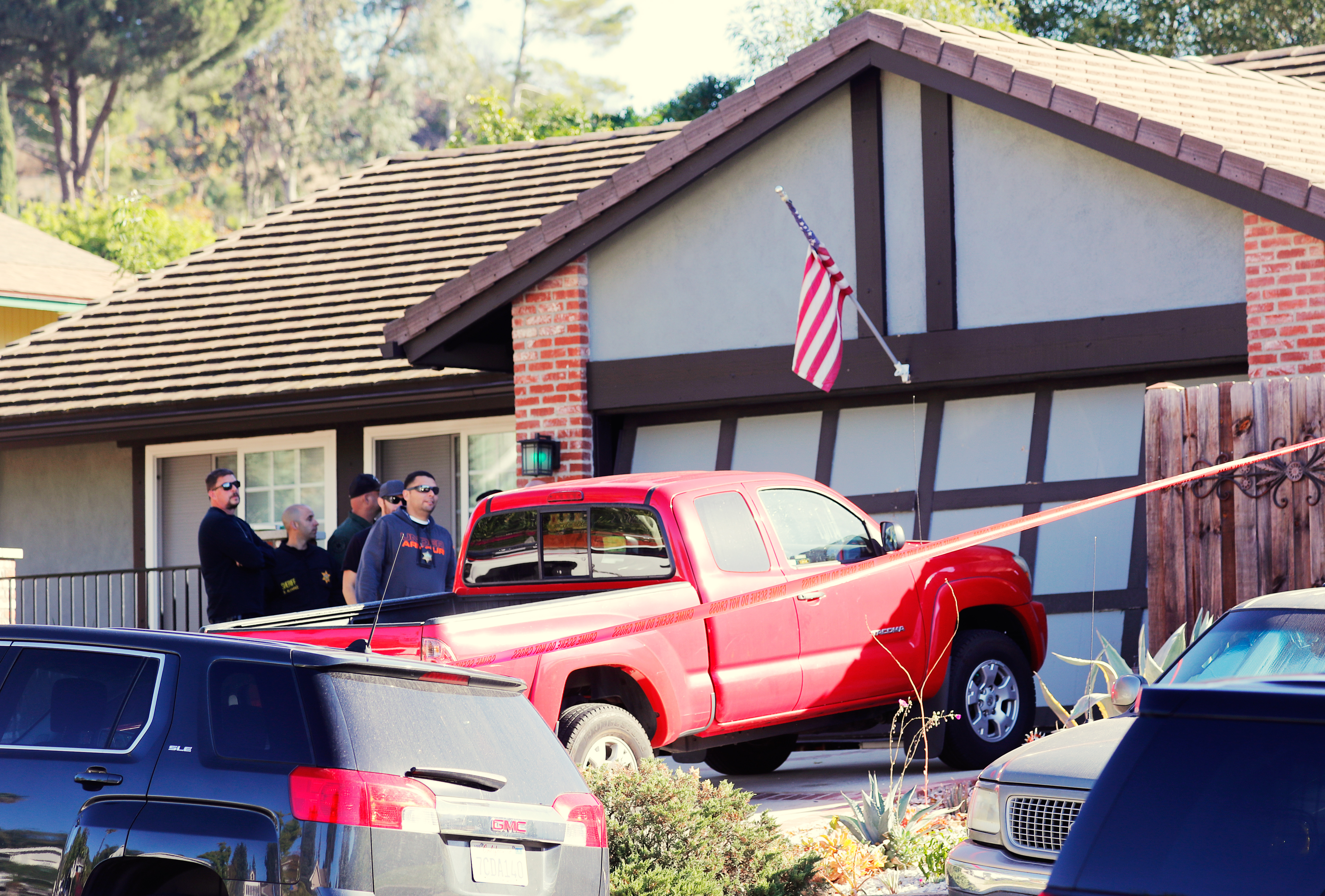 Police and FBI officer wait outside the home of the suspect in a shooting incident at a Thousand Oaks bar, in Newbury Park