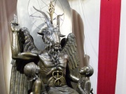 A bronze statue of Baphomet -- a goat-headed winged deity that has been associated with satanism and the occult -- is displayed by the Satanic Temple during its opening in Salem