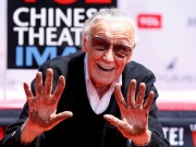 Marvel Comics co-creator Lee shows his hands after placing them in cement during a ceremony in the forecourt of the TCL Chinese theatre in Los Angeles