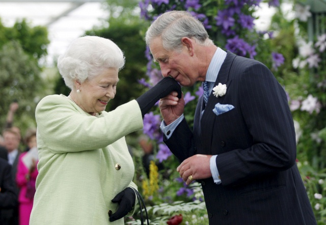 Britain's Prince Charles kisses the hand of his mother, Queen Elizabeth, during a visit to the Chelsea Flower Show in London