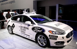 A Ford Fusion hybrid, Level 4 autonomous vehicle is displayed during Press Days of the North American International Auto Show at Cobo Center in Detroit