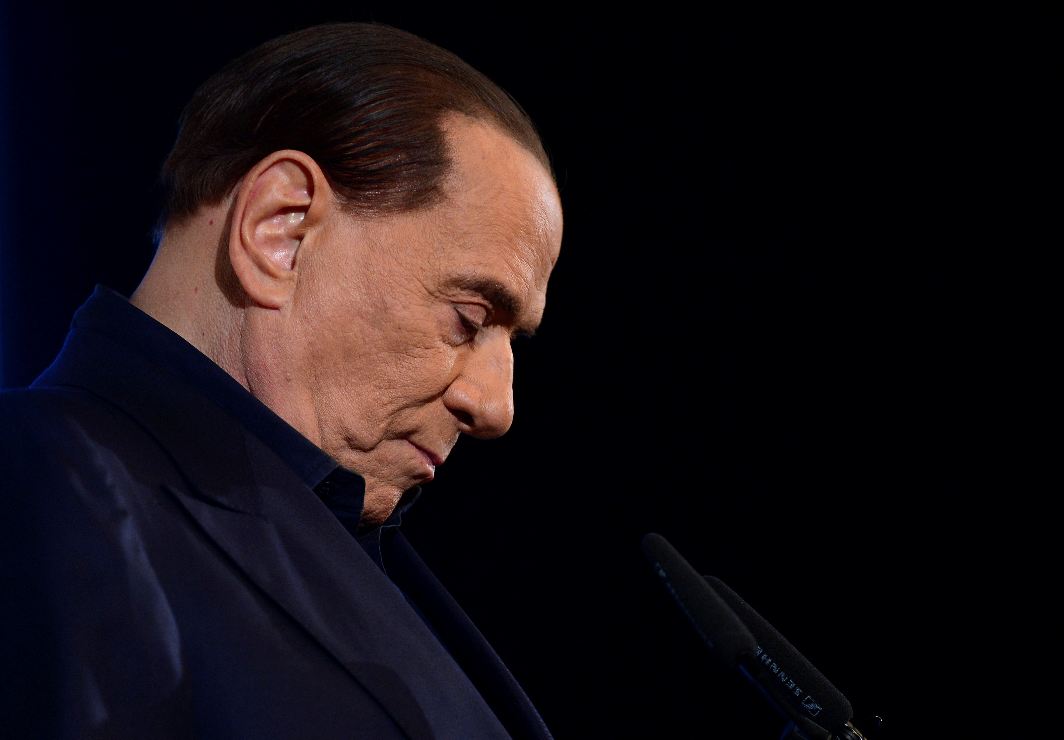 Italian leader of the centre-right party Forza Italia Silvio Berlusconi gestures as he speaks during a pre-election gathering in Milan