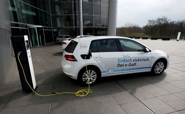 VW e-Golf electric car charges outside the Transparent Factory in Dresden