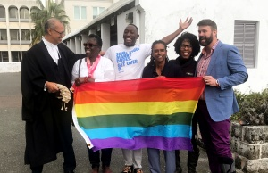 Rod Attride-Stirling, a lawyer who successfully challenged legislation banning gay marriage, poses for a photograph with gay rights supporters in front of court after the hearing, in Hamilton