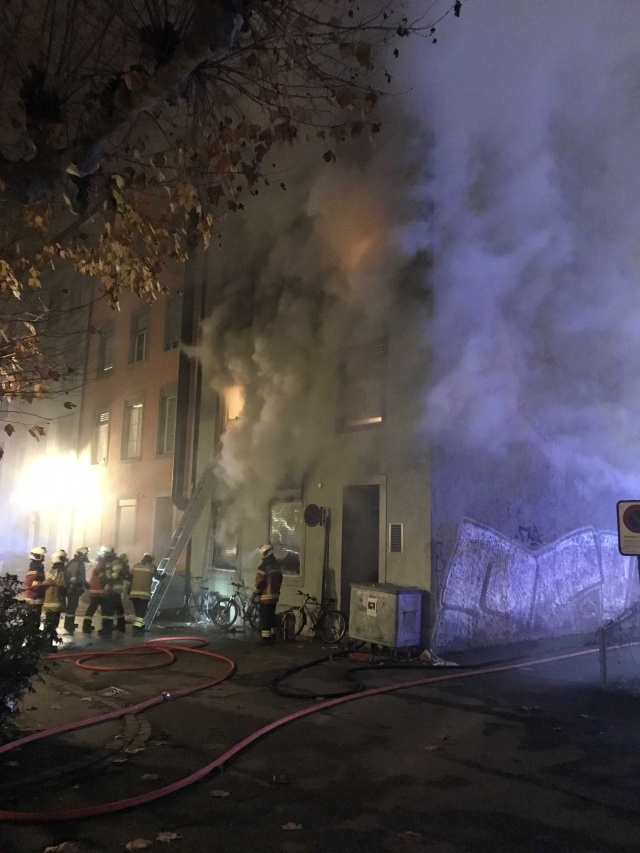 Firefighters are seen in front of a house where six people were killed in an apartment fire early on Monday morning, police said, in Solothurn