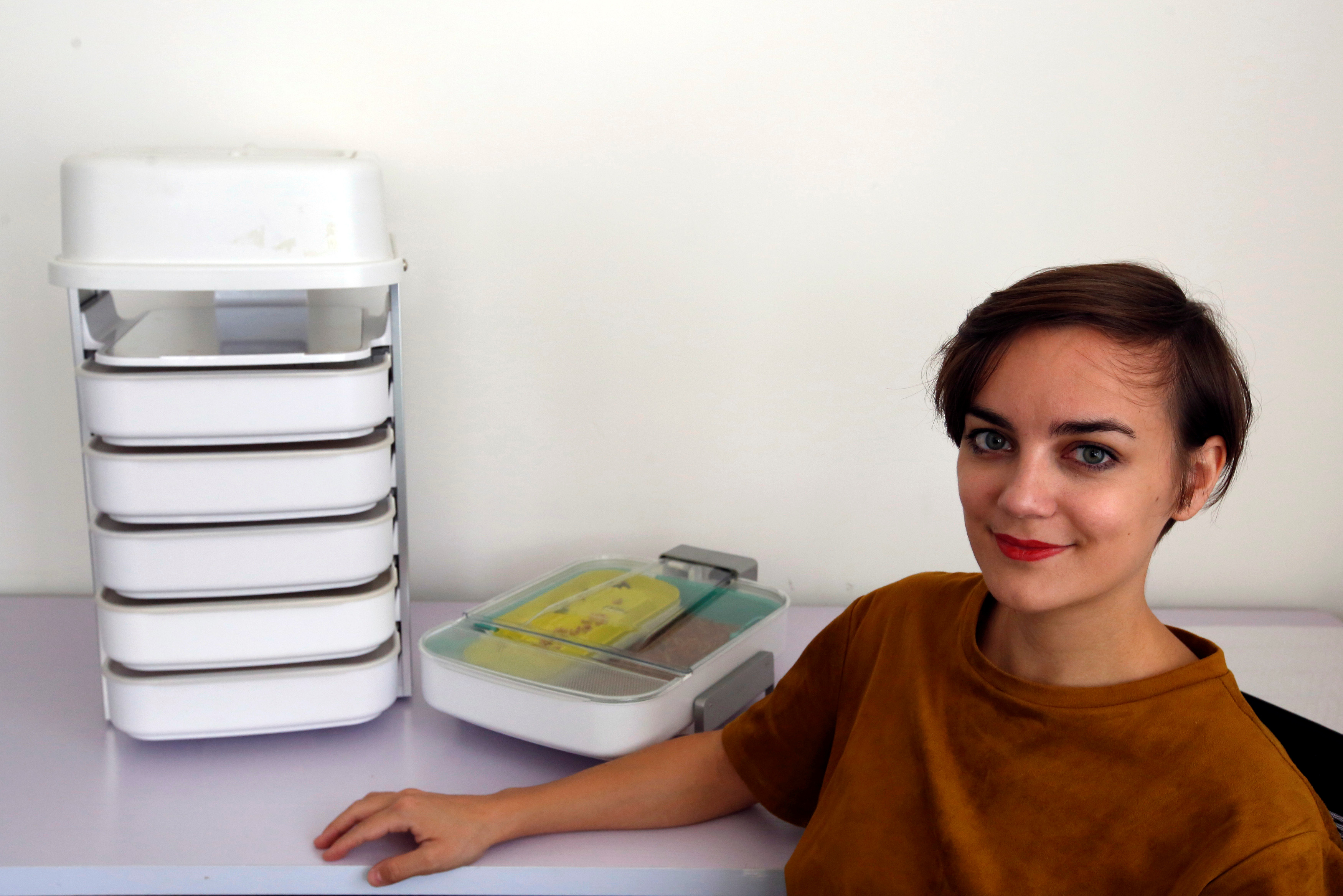 Katharina Unger, founder and CEO of Livin Farms, poses with her mealworm incubators in Hong Kong, China