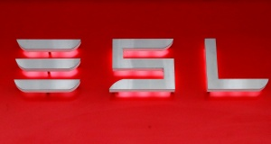 Company logo is seen in front of a showroom of U.S. car manufacturer Tesla in Zurich