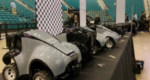 Amazon's AWS DeepRacer cars line a table at the MGM Grand Garden Arena where the cloud computing company opened temporary race tracks after announcing the new product aimed at web developers, in Las Vegas