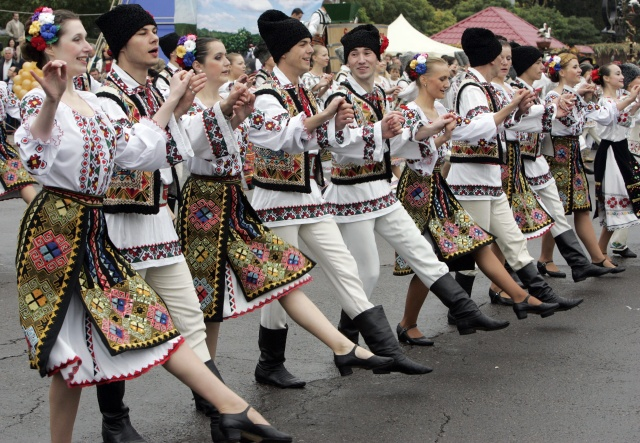 Moldavians dressed in traditional costume dance during opening ceremony of The National Wine Festival in Chisinau