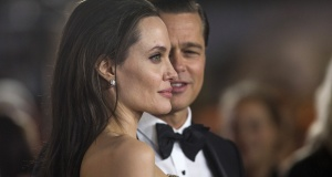 """Director and cast member Jolie and her husband and co-star Pitt pose at the premiere of """"By the Sea"""" during the opening night of AFI FEST 2015 in Hollywood"""