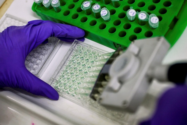 Scientist prepares protein samples for analysis in a lab at the Institute of Cancer Research in Sutton