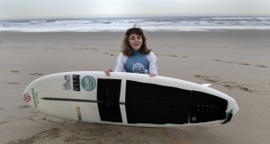 Carmen Lopez Garcia, Spain's first blind female surfer who is to participate in the ISA World Adaptive Surfing Championship, poses before training at Salinas beach