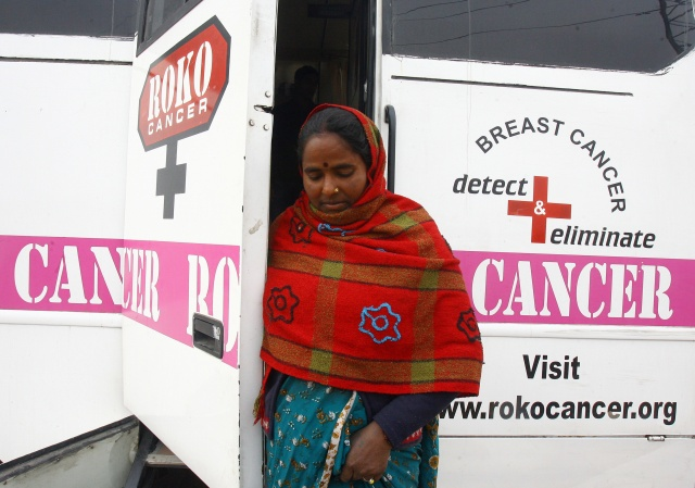 A woman comes out from a mobile cancer detection unit after her mammography examination during a free medical check-up camp in a slum area in Chandigarh